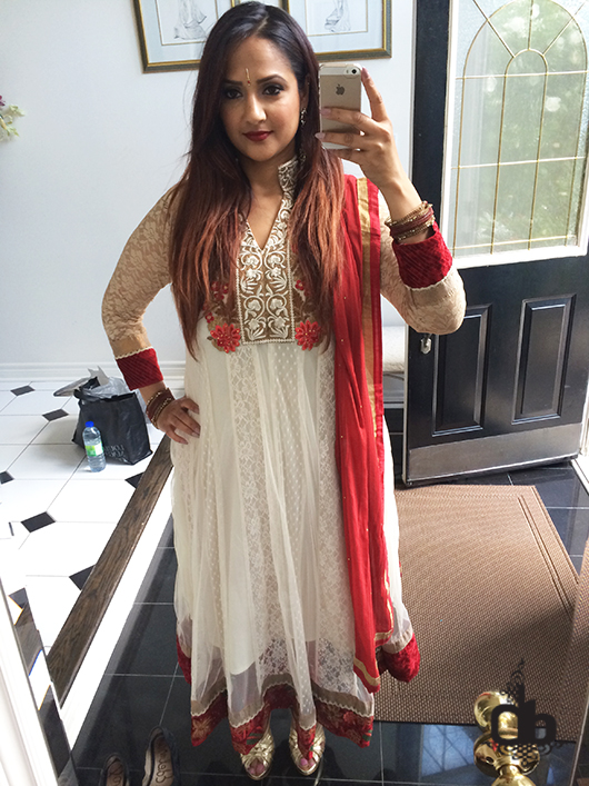 Deepa Berar red suit